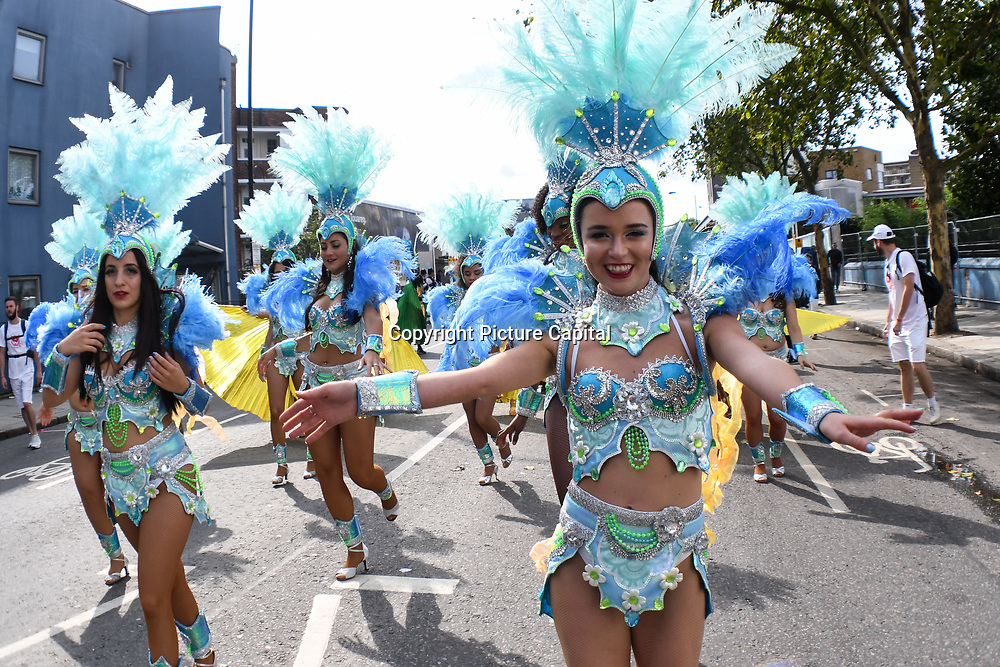 Thousands attend the first day of the Notting Hill Carnival in west London on August 27, 2018. Nearly one million people are expected by the organizers regardless of the wet weather Sunday and Monday in the streets of west London's Notting Hill to celebrate Caribbean culture at a carnival considered the largest street demonstration in Europe and very peaceful atmosphere in London, UK