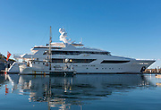 """Well-used fishing boat """"Enterprise"""" pulls into the Port Angeles Boat Haven, past the new Westport 50 meter (164') motor yacht """"My Girl."""""""