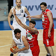 Efes Pilsen's Cenk AKYOL (L) and Pinar Karsiyaka's Sean MARSHALL (C), Jovo STANOJEVIC (R) during their Turkish Basketball Legague Play-Off qualifying first match Efes Pilsen between Pinar Karsiyaka at the Sinan Erdem Arena in Istanbul Turkey on Wednesday 11 May 2011. Photo by TURKPIX