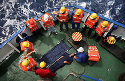 The crew of the Bisanzio practices rescue and fire drills on board the ship while traveling between Egypt and Lebanon in the Mediterranean Sea on April 10, 2008. The Bisanzio, a feeder ship taking containers from Port Said to Beirut, is Lebanese owned, has three different nationalities aboard, and flies a St. Vincent flag.