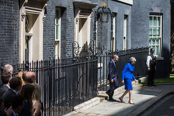 London, UK. 24 July, 2019. Theresa May, accompanied by her husband Philip, leaves 10 Downing Street to address the nation before proceeding to Buckingham Palace to tender her resignation to the Queen.