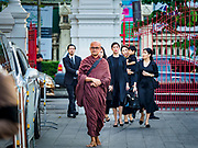 03 NOVEMBER 2018 - BANGKOK, THAILAND:  A Buddhist monk walks into Wat Debsirin ahead of mourners on the first day of funeral rites for Vichai Srivaddhanaprabha. Vichai was the owner of King Power, a Thai duty free conglomerate, and the Leicester City Club, a British Premier League football (soccer) team. He died in a helicopter crash in the parking lot of the King Power stadium in Leicester after a match on October 27. Vichai was Thailand's 5th richest man. The funeral is expected to last one week.   PHOTO BY JACK KURTZ
