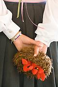 Performer holding cardinal bird nest prop. Svenskarnas Dag Swedish Heritage Day Minnehaha Park Minneapolis Minnesota USA