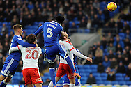 Cardiff City's Bruno Ecuele Manga (5) has his header at goal saved by Barnsley's goalkeeper Adam Davies (out of shot). EFL Skybet championship match, Cardiff city v Barnsley at the Cardiff city stadium in Cardiff, South Wales on Saturday 17th December 2016.<br /> pic by Carl Robertson, Andrew Orchard sports photography.
