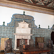 "SINTRA, Portugal - The Magpie Room (Sala das Pegas) is the only room in the palace to have retained its original name since the 15th century. It was described by King Duarte as the Chamber of State, and it was here that notables were received. Despite being restored, the ceiling has retained its original decoration, highlighting the motto of Joao I, ""por bem"" (for good). The Palace of Sintra (Palácio Nacional de Sintra) is a mediaeval royal palace in Sintra and part of the UNESCO World Heritage Site that encompasses several sites in and around Sintra, just outside Lisbon. The palace dates to at least the early 15th century and was at its peak during the 15th and 16th centuries. It remains one of the best-preserved royal residences in Portugal."