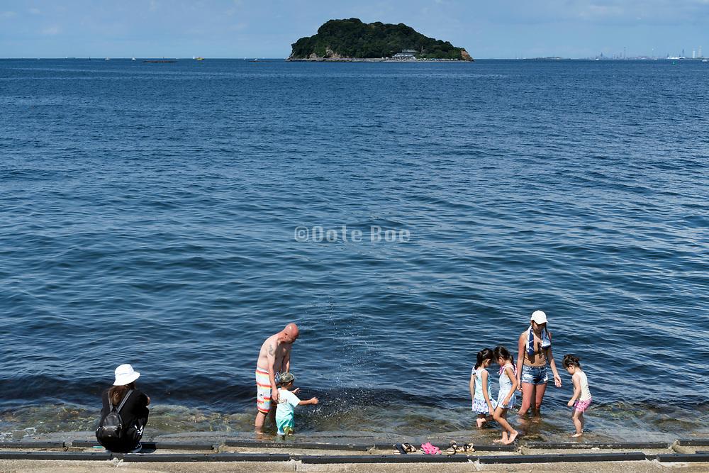 family cooling off at Umikaze park, Yokosuka with Tokyo Bay and Sarushima Island