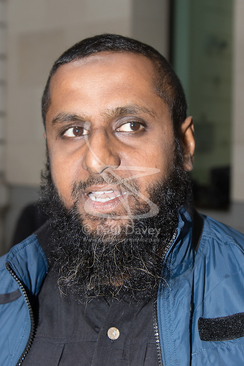 """Westminster Magistrates Court, London, August 5th 2015. Islamist Anjem Choudary is denied bail on terror charges at Westminster Magistrates Court. A colleague Mohammad Shamsuddin, also known as Abu Saalihah issued a press statement saying Choudary and his co-accused Mohammed Rahman will be remanded in custody until August 28th and declared the charges as part of an ongoing persecution of Muslims, declaring that """"one day the black flag of Islam WILL be flying over Westminster"""". PICTURED: Close associate of Anjem Choudary Abdul Muhid arrives at Westminster Magistrates Court PICTURED: Mohammad Shamsuddin, also known as Abu Saalihah issues a press statement."""