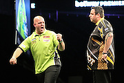 Michael van Gerwen beats Adrian Lewis to reach the final during the Betway Premier League Darts Play-Offs at the O2 Arena, London, United Kingdom on 19 May 2016. Photo by Shane Healey.