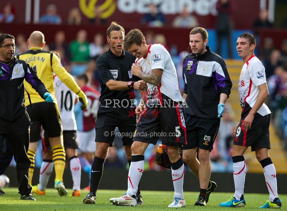 LIVERPOOL, ENGLAND - Saturday, August 24, 2013: Liverpool's Daniel Agger injured during the Premiership match against Aston Villa at Villa Park. (Pic by David Rawcliffe/Propaganda)