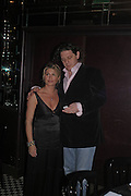 Marco Pierre White and his wife Mati. fund raising dinner hosted  by Marco Pierre White and Franki Dettori at  Frankie's. Knightsbridge. 17 January 2004. ONE TIME USE ONLY - DO NOT ARCHIVE  © Copyright Photograph by Dafydd Jones 66 Stockwell Park Rd. London SW9 0DA Tel 020 7733 0108 www.dafjones.com