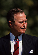 The President H W Bush (Bush 41) smirk is evident at an arrival ceremony for Carlos Perez President of Venezuela in May 1990...Photograph by Dennis Brack bb25