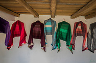 Shawls hanging on the wall, woven by Kichwa weavers in La Calera