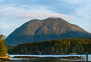 A mountain on Meares Island catches the morning light, viewed from the North shore of Tofino, Vancouver Island, British Columbia
