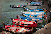 Fishing boats in the harbor in Vernazza on the Cinque Terre, Italy