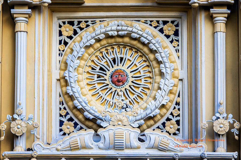 Sunny Face:  A face is set within radiance as given by the sun, on the front relief of the Hindu Raghunath Mandir temple, Jammu India.