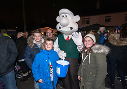 © Licensed to London News Pictures. 01/12/2015. Bristol, UK.  'Wallace' from Wallace and Gromit at the Brailsford family's Christmas Lights Big Switch On. Brothers Lee and Paul Brailsford have spent 20 years and more than £20,000 building up their huge collection of festive decorations in Bentry, Bristol to turn the home of their mother Rosemary into a winter wonderland every year. They have tens of thousands of lights, a life-size nativity, trains, snowmen, toy soldiers, reindeers, Santas and a snow machine. They raise money from people who flock to see the spectacle and to date they have raised more than £30,000 for charities such as the Wallace and Gromit Appeal that supports Bristol Children's Hospital.  The electricity and replacement lights cost around £1,000 each year, but this year the brothers are trying to convert everything to LED lights to be more efficient for Bristol's year as European Green capital 2015. Photo credit : Simon Chapman/LNP