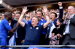 Cardiff City owner Vincent Tan celebrates winning promotion to the Premier League with Cardiff City manager Neil Warnock at the end of the Sky Bet Championship match at the Cardiff City Stadium.