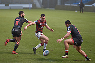 Harry Smith (20) of Wigan Warriors puts in the grubber kick