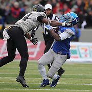 Chris Carnegie, (left), Army, assists in the tackle of Garrett Brown, Air Force, during the Army Black Knights Vs Air Force Falcons, College Football match at Michie Stadium, West Point. New York. Air Force won the game 23-6. West Point, New York, USA. 1st November 2014. Photo Tim Clayton