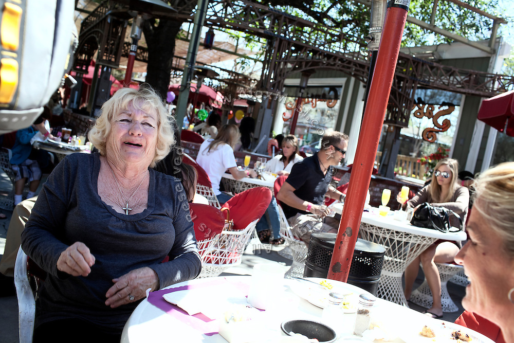 A middle-aged woman is laughing during lunch at the Sagebrush Cantina, 23527 Calabasas Rd, Calabasas, CA 91302, USA, where Alexis Neisers, a member of the Bling Ring, used to work as a waitress.