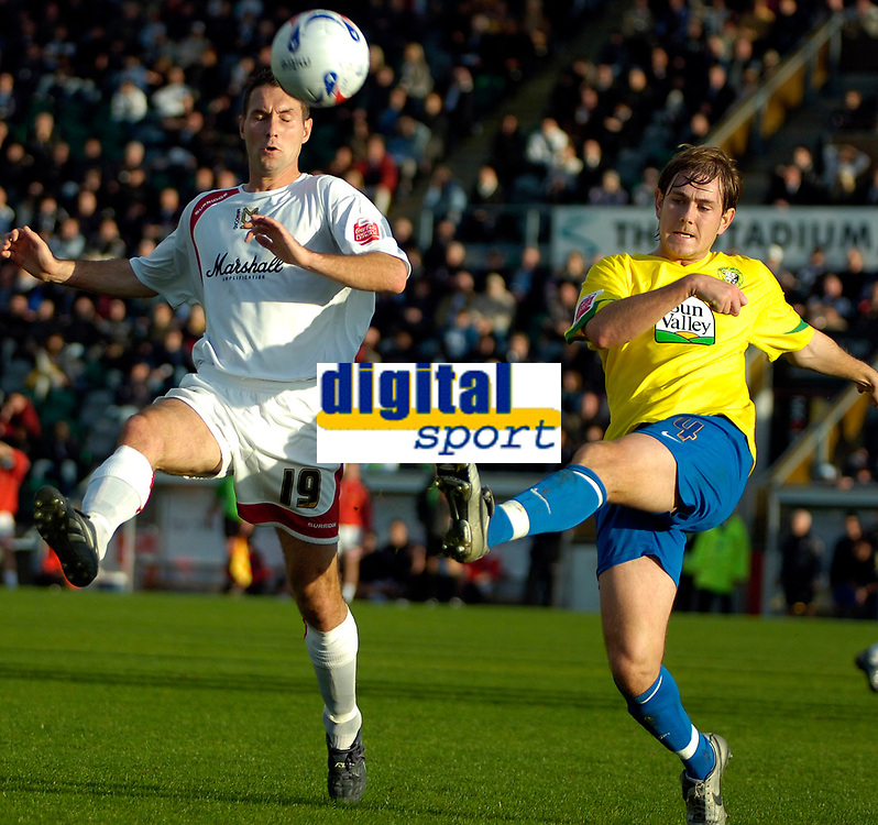 Photo: Ed Godden.<br /> Milton Keynes Dons v Hereford United. Coca Cola Championship. 21/10/2006. Hereford's Richard Rose (R) clears the ball away from the oncoming Scott Taylor.
