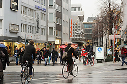 Cologne, Germany, Jan. 2012 -  Pedestrians and cyclists make their way along Breite Strasse a popular shopping area in Cologne, Germany. (Photo © Jock Fistick).