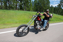 Travis Smith of Wyoming riding his 1200 Sportster on the Cycle Source ride down Vanocker Canyon back from Nemo to the Iron Horst Saloon during the Sturgis Black Hills Motorcycle Rally. SD, USA. Wednesday, August 7, 2019. Photography ©2019 Michael Lichter.
