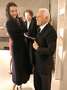 Saffron Burrows, Mike Figgis and Armani. Armani shop opening. New Bond St. 19/2/02© Copyright Photograph by Dafydd Jones 66 Stockwell Park Rd. London SW9 0DA Tel 020 7733 0108 www.dafjones.com