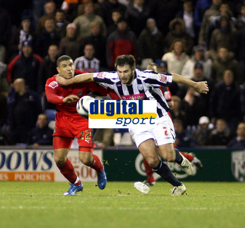 Photo: Mark Stephenson/Sportsbeat Images.<br /> West Bromwich Albion v Coventry City. Coca Cola Championship. 04/12/2007.West Brom's Carl Hoefkens gets the better of Leon Best
