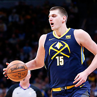 07 March 2018: Denver Nuggets center Nikola Jokic (15) brings the ball up court during the Cleveland Cavaliers 113-108 victory over the Denver Nuggets, at the Pepsi Center, Denver, Colorado, USA.