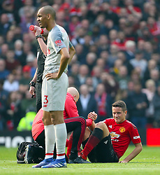 Manchester United's Ander Herrera receives medical attention on the pitch