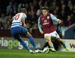 Aston Villa's Jack Grealish takes on Queens Park Rangers's Karl Henry - Photo mandatory by-line: Robbie Stephenson/JMP - Mobile: 07966 386802 - 07/04/2015 - SPORT - Football - Birmingham - Villa Park - Aston Villa v Queens Park Rangers - Barclays Premier League