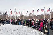 Goshen, New York - People gathered at Orange County Veterans Memorial Cemetery listen to a speaker during a Wreaths Across America ceremony on Dec. 16, 2017. About 3,000 wreaths were placed at graves, and small American flags were added to the wreaths at veterans' graves.