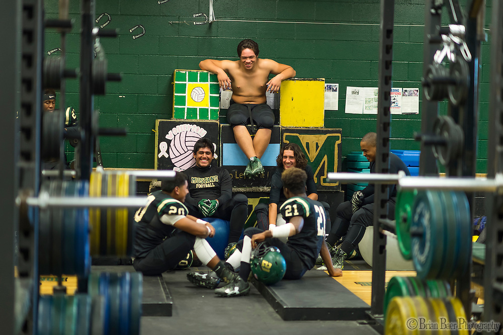 Monterey Trail Mustangs Wayne K. Doroen iii (54), sits on boxes inside the weight room before the game as the Monterey Trail Mustangs host the Sheldon High School Huskies Friday Sep 23, 2016.<br /> photo by Brian Baer