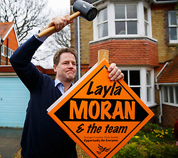 © Licensed to London News Pictures. 29/03/2015. Abingdon, UK. Liberal Democrat leader Nick Clegg hammering a steakboard for Layla Moran as he launches his party's general election campaign at Albert Park in Abingdon on Sunday, 29 March 2015. Photo credit : Tolga Akmen/LNP
