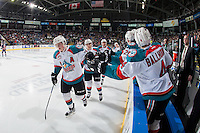 KELOWNA, CANADA - JANUARY 27: Lucas Johansen #7, Nick Merkley #10 and Devante Stephens #21 of the Kelowna Rockets skate by the bench celebrating a goal against the Kamloops Blazers on January 27, 2017 at Prospera Place in Kelowna, British Columbia, Canada.  (Photo by Marissa Baecker/Shoot the Breeze)  *** Local Caption ***