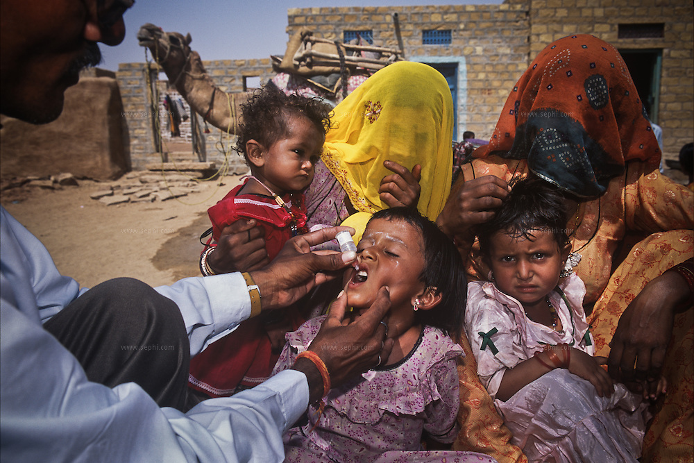 During the country's April 2004 NIDs, mothers in the Mohamedan (Muslim) Village Chatrel, in Jaisalmer district of Rajasthan, wait their turn for their babies to be vaccinated.
