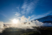 Geysir Geothermal Area - steam rising from a field of hot pools and water spouts at one of Iceland's most famous geysers