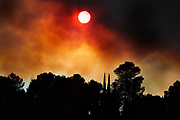 Out of control fire creating smoke obscuring the afternoon sun, 14th August 2019, Lagrasse, France. In the United States, the burning of fossil fuels to make electricity is the largest source of heat-trapping pollution, producing about two billion tons of CO2 every year. Coal-burning power plants are by far the biggest polluters. The country's second-largest source of carbon pollution is the transportation sector.