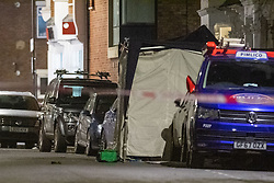 © Licensed to London News Pictures. 12/02/2021. London, UK. A medical bag sits next to a forensic tent on Ackmar Road after a man, believed to be aged 19, died from stab injuries. Police were called at 18:42GMT on Thursday 11th February to reports of a fight between three males in Ackmar Road in Parsons Green, the man was pronounced dead at the scene at 19:28GMT. Photo credit: Peter Manning/LNP