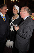 Richard Briggs, Julian Fellowes and Lady Emma Kitchener-Fellowes. Reception to support the Hyde Park Appeal for Liberty Drives ( a charity which enables people to travel around Hyde Park in electric buggies) in the presence of Prince Michael of Kent. Officers Mess. Household Cavalry Mounted Regiment. Hyde Park Barracks. 30 November 2004. ONE TIME USE ONLY - DO NOT ARCHIVE  © Copyright Photograph by Dafydd Jones 66 Stockwell Park Rd. London SW9 0DA Tel 020 7733 0108 www.dafjones.com