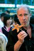 On a Beijing street, photojournalist Peter Menzel discovers that the taste and texture of a deep-fried starfish are less than stellar. Hungry Planet: What the World Eats (p. 287).