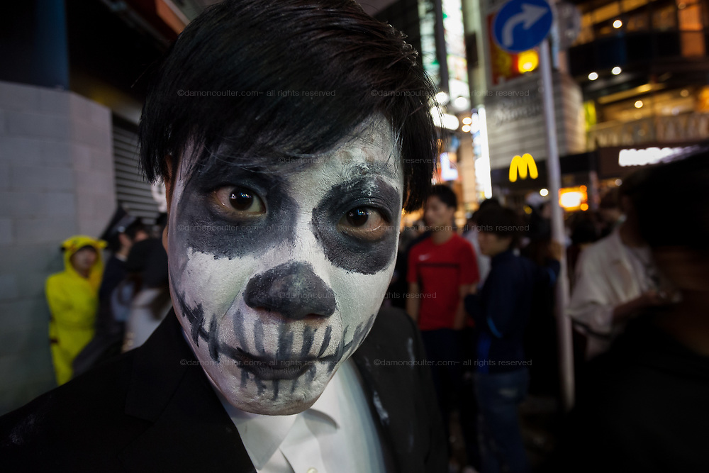A man in ghostly make-up during the Halloween celebrations Shibuya, Tokyo, Japan. Sunday morning October 28th 2018