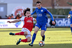 Leicester City's Ben Chillwell is tackled by Fleetwood Towns' Markus Schwabl