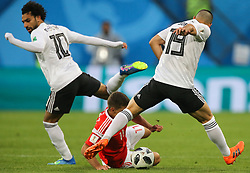 June 19, 2018 - Saint Petersburg, Russia - Mohamed Salah (L), Abdalla Said of the Egypt national football team vie for the ball during the 2018 FIFA World Cup match, first stage - Group A between Russia and Egypt at Saint Petersburg Stadium on June 19, 2018 in St. Petersburg, Russia. (Credit Image: © Igor Russak/NurPhoto via ZUMA Press)