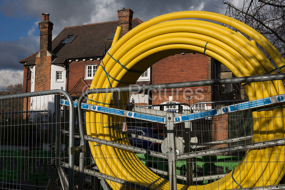 A gas supply contractors yellow sleeve is coiled on a trailer before instillation under the paths of a residential street in Lambeth, on 30th January 2018, in London, England.