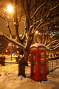 Weather, climate change. London, Britain and Europe, is gripped by a big freeze. Winter conditions which are likened to Siberia swept across Europe, bringing traffic and transport to a halt, closing schools and stopping millions of people going to work. Whilst most buses and tubes were not working, some commuters and tourists got to central London to enjoy the freak snow.///A Red London Telephone box in the snow