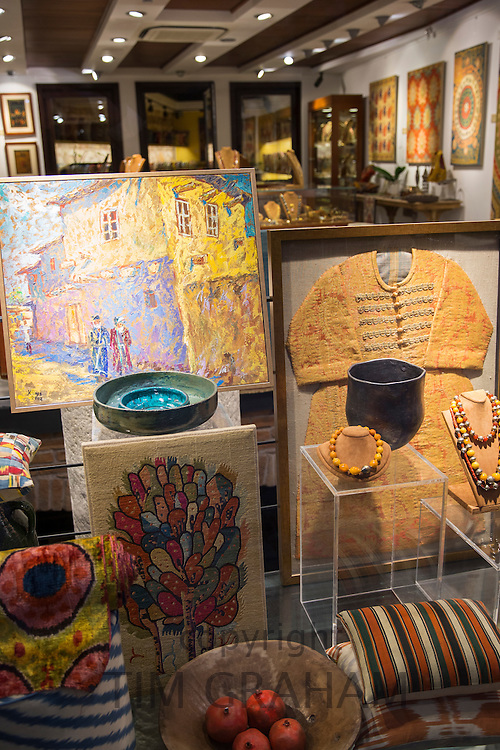 Traditional Turkish antiques, beads and paintings in souvenirs shop window in Istanbul, Republic of Turkey.
