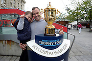 Father and son Rugby fans pose with the Webb Ellis Trophy. RWC 2015, Coca Cola London Eye launch for the Rugby World cup event  in London on Tuesday 15th Sept  2015.<br /> pic by John Patrick Fletcher, Andrew Orchard sports photography.