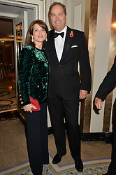 The HON.HARRY HERBERT and his wife CHICA at the 24th Cartier Racing Awards held at The Dorchester, Park Lane, London on 11th November 2014.